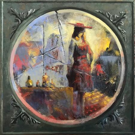 Woman's reflection in a broken mirror